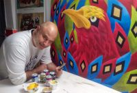 Oscar Salerni in front of the painting The Phoenix